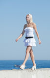 Slim girl in white outdoors Royalty Free Stock Image
