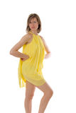 Slim girl in a yellow dress Royalty Free Stock Photos