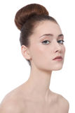 Slim girl. Young beautiful slim girl with hair bun over white background Stock Images