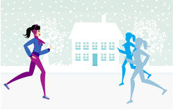Slim girls running in winter Stock Photo