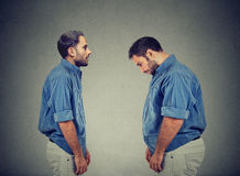 Slim guy looking at fat man himself. Diet choice concept Royalty Free Stock Images