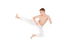 Slim guy practicing martial art royalty free stock image