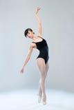 Slim gymnast dancing Stock Images