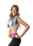 Slim happy woman working out with dumbbells Royalty Free Stock Image