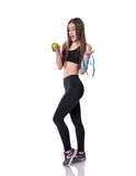 Slim and healthy young woman holding measure tape and apple isolated on white background. Weight loss and diet concept. Stock Photo