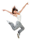 Slim hip-hop style teenage girl dancer jumping dancing Stock Photo