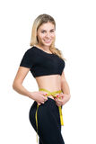 Slim isolated woman shows waist with measuring tape Royalty Free Stock Photo