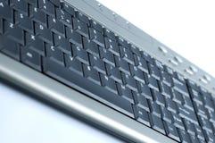 Slim keyboard. Silver keyboard with black keys Stock Images