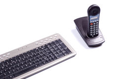 Slim keyboard. And blue telephone Royalty Free Stock Images