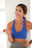 Slim lady doing exercise with dumbbell Stock Images
