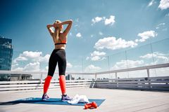 Free Slim Lady Is Warming-up Before Fitness On Sunny Roof Royalty Free Stock Image - 122510856