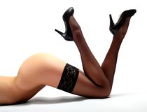 Slim legs in black nylons Royalty Free Stock Photos