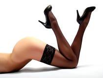 Slim legs in black nylons Royalty Free Stock Photos