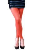 Slim long female crossed legs Royalty Free Stock Images