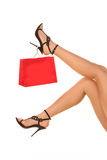 Slim long sexy woman legs  in highheels with shopping bag. Shopping concep. T Stock Image