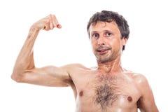 Slim man showing biceps Royalty Free Stock Images