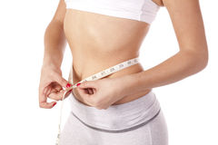 Slim measuring waist Royalty Free Stock Photo