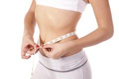 Slim measuring waist Royalty Free Stock Photo