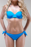 Slim model in blue bikini, studio shot Stock Image