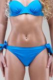 Slim model in blue bikini, studio shot Stock Images