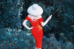 Free Slim Model In Hat. Retro Woman In Red Polka Dot Dress On Green Summer Background. Stand Back. Vintage Girl In Long Gloves On Stock Photos - 159347403