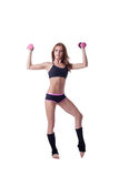 Slim muscular woman isolated on white background Royalty Free Stock Images