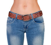 Slim naked girl in jeans Stock Images