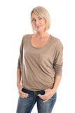 Slim nice smiling older woman isolated over white wearing jeans Stock Image