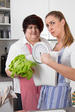 Slim and overweight women talking about nutrition Stock Images