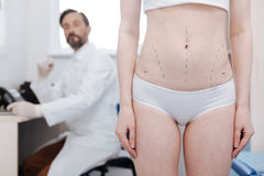 Slim petite woman intending making a plastic surgery Stock Photography