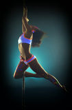 Slim pole dancer posing with glowing UV makeup Stock Photography