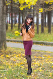 Slim pretty girl in an autumn forest Royalty Free Stock Photography