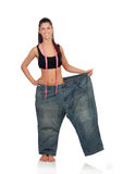 Slim pretty girl with a big trousers Royalty Free Stock Image