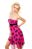 Slim pretty girl in a pink dress Stock Images