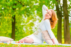 Slim pretty girl spend a weekend in  park Royalty Free Stock Photo