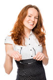 Slim secretary with red hair holds glasses Royalty Free Stock Photography