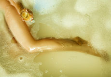 Slim sexy blonde girl taking bath with glass of champagne Royalty Free Stock Photography