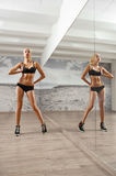 Slim, sexy,blonde, young sportswoman with athletic body, pumped Royalty Free Stock Photos
