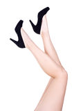 Slim sexy female legs in shoes on high heels isolated on white Royalty Free Stock Image