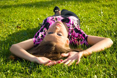 Slim sexy girl on a green grass Royalty Free Stock Images