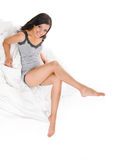 Slim sexy woman in bed Stock Image