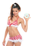Slim sexy woman in christmas new year bikin Royalty Free Stock Photos