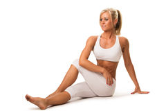 Slim woman doing stretching exercise stock photography
