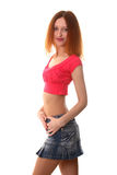 Slim smiling girl. Red-haired girl with naked belly Royalty Free Stock Images