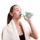 Slim sport girl with bottle of water and towel Stock Photos