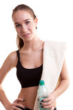 Slim sport girl with bottle of water and towel Royalty Free Stock Images
