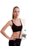 Slim sport girl with bottle of water and towel Stock Photo
