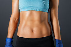 Slim sportive woman torso with strong muscles Royalty Free Stock Images