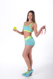 Slim sports woman with apple and measuring tape stock image