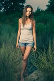 Slim sporty women standing in grass stock images